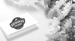 Sherlock's Escapes card and flowers