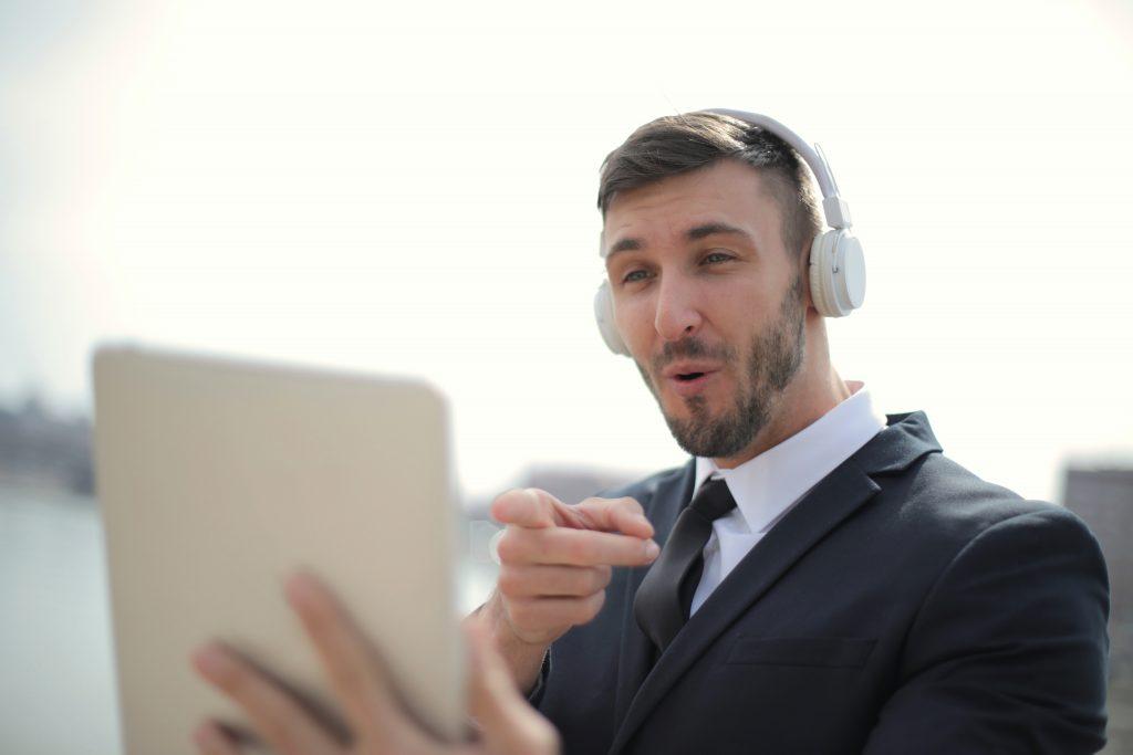 Man pointing at tablet
